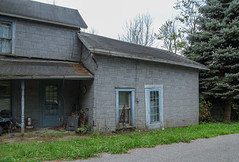 Log House (?) — Liberty Township, Logan County, Ohio (Pythaglio) Tags: road county trees windows ohio house west grass pen altered concrete liberty log doors post neglected shingle 11 historic single porch vacant gutter logan siding residence asphalt turned township dwelling insulbrick 15story twobay