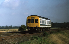 Class 101 DMU near Sandy, ECML, 17/07/1978 [slide 7806] (graeme9022) Tags: uk blue england white train br mechanical diesel metro transport rail off transportation multiple british local passenger 1970s eastern region railways metropolitan regional unit refurbished livery stopping cammell mainline cammel