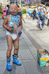 NYC100248/ (Glenn Losack, M.D.) Tags: street new york nyc money square babies photographer manhattan glenn photojournalism times diapers performers 42nd losack