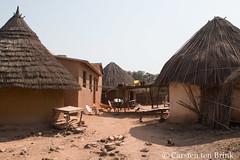 "Among the ""orpailleurs"", the goldminers of the Kédougou region - in the village: is a wheelbarrow without a wheel a chair? (10b travelling / Carsten ten Brink) Tags: 1000plus 10btravelling 2013 africa african afrika afrique carstentenbrink iptcbasic kedougou kereconko kédougou mako niokolokoba people places senegal sénégal tambacounda tomboroncotou tomboronkoto westafrica years africaine agriculture artesanal artisanal crime damage digging environment environmental gold goldmining lesénégal manual miner mineral mining or orpailleurs panning prostitution region tenbrink water wheelbarrow"