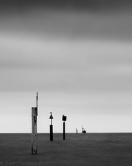 Buoy line (Stuart Feurtado) Tags: longexposure monochrome coast leefilters littlestopper le blackandwhite seaside groyne buoy sea outdoor