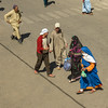Separate worlds (Adaptabilly) Tags: africa man taroudant desert travel woman people city outdoor lumixgx7 portrait pavement morocco igherm
