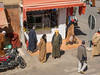 Outside the fish shop (Adaptabilly) Tags: africa man taroudant building desert travel portrait people window city outdoor wall shopping lumixgx7 morocco igherm