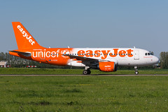 """G-EZIO - easyJet - Airbus A319-111 - """"Unicef"""" special colours (5B-DUS) Tags: gezio easyjet airbus a319111 unicef special colours a319 ams amsterdam schiphol airport aircraft airplane aviation flughafen flugzeug planespotting plane spotting netherlands"""