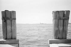 """There she is"", Battery Park, Manhattan, NYC (felixmiddendorf) Tags: 35mmfilm adonal150 batterypark kodaktrix400 libertyisland lowermanhattan manhattan newengland2016 newyork newyorkcity nikoncoolscan5000ed olympusxa statueofliberty usa"