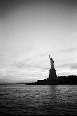 """Standing Proud"", Liberty Island, NYC (felixmiddendorf) Tags: 35mmfilm adonal150 clippercity kodaktrix400 libertyisland lowermanhattan manhattan newengland2016 newyork newyorkcity nikoncoolscan5000ed olympusxa statueofliberty usa"