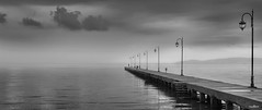 seascape (dim.pagiantzas | photography) Tags: seascape sea reflections serenity sky clouds cloudy lights bridge water grayscale outdoor street canon misty fog