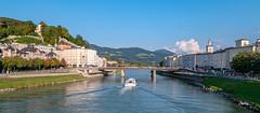 Making postcards in Salzburg (VisualFlux™) Tags: salzburg salzachriver bluesky clouds tourboat architecture cityscape europe austria alpine summeretime