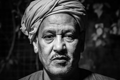 Cairo Street Portrait (Mark Fischer) Tags: street portrait monochrome night sony egypt cairo fischerfotos ilce7 mohandaseen a7 egypte sel55f18z zeiss sonnartfe1855