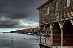 mussel village (dim.pagiantzas   photography) Tags: mussel village house cottage wood wooden sea seascape water waterscape landscape atmospheric sky clouds cloudy boats boating fishing nature outdoor sony windows colors bluesky horizon