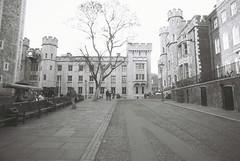 Tower of London (goodfella2459) Tags: nikonf4 afnikkor24mmf28dlens ilfordpanfplus50 35mm blackandwhite film analog london buildings tree toweroflondon history bwfp manilovefilm