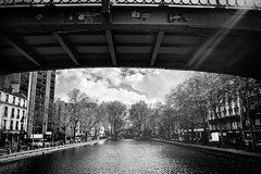 Under the mobile bridge – looking back (marc.barrot) Tags: waterway canal urbanlandscape monochrome france paris 75010 canalsaintmartin pontmobile