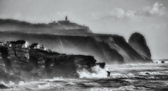 'Storm Watch' (Canadapt) Tags: sea ocean surf waves spray wind gust lighthouse coast cliff village bw magoito portugal canadapt