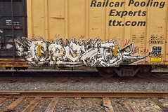 EPOXE (TheGraffitiHunters) Tags: graffiti graff spray paint street art colorful benching benched freight train tracks boxcar epoxe