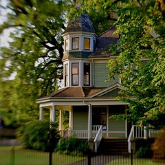 It Still Meant Home To Him (MPnormaleye) Tags: house home architecture gingerbread gothic turret gable victorian dreamy nostalgic historic trees yard lawn village neighborhood lensbaby seeinanewway