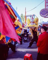 Lion Dances in March (Taomeister) Tags: 65mmf4n mamiya7 fujifilmvelvia100 expiredfilm rvp100 43mmf45n