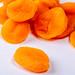 Dry apricots fruit on white background close up