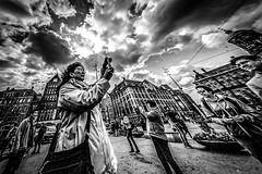 watch and be watched (Gerrit-Jan Visser) Tags: bewerkt streetphotography amsterdam damsquare bnw blackandwhite people smartphone phone photographs watching posing