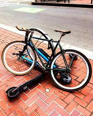 20190415 bike-rack-fighting-over-parking (Jym Dyer) Tags: bicycle bikerack bikesf escooter sanfrancisco sharrow