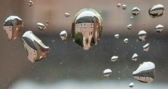 Through the fish-eyed lens (Zog the Frog) Tags: raindrops window refraction lens fisheye macro panasonic30mmmacro