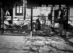 At the Café (Oddras) Tags: streetphotography street streetphoto bnw blackandwhite blackwhite streetmood lund