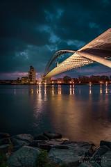 A7305879_s (AndiP66) Tags: dreiländerbrücke threecountriesbridge passerelledestroispays brücke bridge bogenbrücke archbridge dietmarfeichtinger weilamrhein huningue elsass dreiländer dreiländereck deutschland germany frankreich france schweiz schwitzerland blauestunde bluehour wolken clouds lichter lights sony sonyalpha 7markiii 7iii 7m3 a7iii alpha ilce7m3 sonyfe24105mmf4goss sony24105mm 24105mm emount sel24105g andreaspeters
