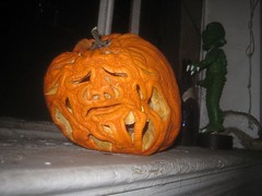 Pruneface from Dick Tracy 2008 Halloween Pumpkin 9913 (Brechtbug) Tags: second pruneface villain jack o lantern carved 2008 its various stages decay nyc window sill new york city holiday orange rotting gourd newspaper news paper cartoon comics sunday funnies strip prune face african art bird mexican skeleton
