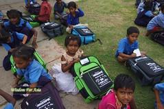 WFABTS08473 (Wisdomforasia) Tags: backpacks backtoschool wisdomforasia village children helping schoolsupplies