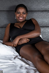 Magic smile (tnekralc) Tags: model kirezi magic smile sexy sex no undies head face eyes mouth lips hair neck shoulders arms hands bed sheets white black dress legs tits cleavage brown skin