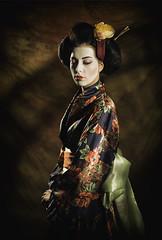 Geisha (Pawel Wietecha) Tags: geisha japanese kimono girl woman lady model studio light new art emotions portrait eyes look face hair pretty beauty glamour people makeup style dark pawel wietecha femme fille dame beauté belleza dama niña bellezza signora ragazza belle color colors red green orange dress