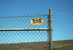 Dungeons & Dragons? (LeftCoastKenny) Tags: coyotecreektrail hill fence sign text
