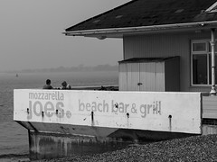 Solent Beach Cafe-F4170754 (tony.rummery) Tags: absorbed beach blackandwhite cafe channel em5mkii mft microfourthirds mist omd olympus people portsmouth solent southcoast southsea street talking england unitedkingdom