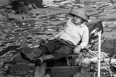 The boatman relaxes (57Andrew) Tags: boatman hat october leica 2010 summicron relaxing boat saikung 90mm m9