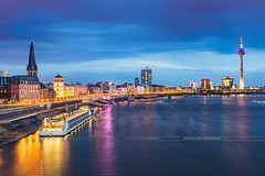 Evening in Dusseldorf (Michael Abid) Tags: düsseldorf dusseldorf duesseldorf germany night skyline rhein rhine tower landmark famous river cityscape panorama architecture building boat ship city church promenade riverside