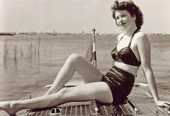 Woman in Swimsuit Posing on Boat, 1940s (StevenM_61) Tags: woman swimsuit bathingsuit boat 1940s
