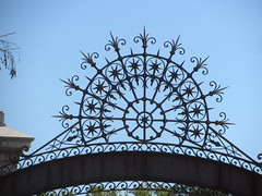 Decorative part of gate to grounds of Casa Arabe,  Calle O'Donnell, Barrio Salamanca, Madrid (d.kevan) Tags: casaarabe grounds gates entrances decorativedetail madrid barriosalamanca calleodonnell metalwork wroughtiron