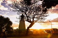 Diego Suarez (Rod Waddington) Tags: africa afrique afrika diego suarez north madagascar malagasy statue sunset trees streetphotography road taxi sky clouds outdoor landscape urban