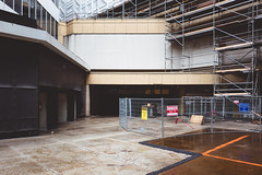 for.the.time.being (jonathancastellino) Tags: toronto architecture rain leica q series vernacular fence construction vacant abandoned shop store eatoncentre