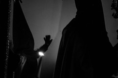 Tacto_2 (alejandrozujar) Tags: semanasanta sevilla guadalcanal blackandwhite niños nazareno costalero palio cristo light dark kids vela fire fuego mobile sky place tradition