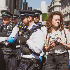 Police, Camera, Action (DobingDesign) Tags: police metropolitanpolice uniforms journalist streetphotography group london londonstreets protest extinctionrebellion climatechangeprotest oxfordcircus people chaos protesters handcuffs equipment baton candid