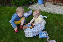 Hamish helping Molly unwrap her birthday present (timnutt) Tags: toddler xt2 child marketharborough people fuji 35f2wr 35mm fujifilm children