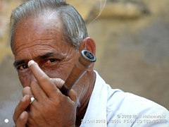 2012-01d Smoking 2018 (05) (Matt Hahnewald) Tags: matthahnewaldphotography facingtheworld people character head face eyes expression lookingatcamera pipe smoke chillum tobacco smoker smoking bodylanguage bothhands consent quality super concept humanity living culture tradition lifestyle habit relaxation local traditional cultural roadside village stranger nawalgarh shekhawati rajasthan india asia asian indian rajasthani individual oneperson male adult middleaged man physiognomy nikond610 nikkorafs85mmf18g 85mm 4x3ratio resized 1200x900pixels horizontal street portrait halflength closeup threequarterview outdoor posing authentic holding