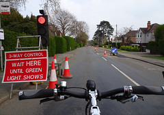 Waiting here (stevenbrandist) Tags: cycling commute commuting trafficlights trafficcone cones quorn leicestershire sign red temporary roadworks moulton tsr busstop