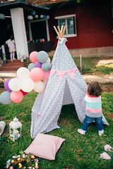 A child standing in front of a teepee. Easter picnic (Ivan Radic) Tags: easter haus hof mädchen ostern picknick zelt adorable athome back backstage balloons behind celebration child childhood colorful cute decoration drausen dress egg family feiern female froheostern fun funny girl grass happy happyeaster house lifestyle little littlegirl natural outdoors picnic playful portrait springstyle teepee toddler twoyears yard young nikond610 sigma35mmf14dghsmart