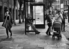 A Mobile Society (Rico Shay) Tags: people peoplewatching mobilephone london lovephotography sundaylights person busstop