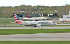 One Going, Two Staying (craigsanders429) Tags: americanairlines jetliners jets 737 boeing737 737800 johnglenncolumbusinternationalairport aircraft airlines airliners airplanes airports airportrunways departingaircraft takeoffroll