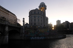 URANIA BY THE DANUBE CANAL IN VIENNA (artofthemystic) Tags: austria danubecanal vienna urbanart graffiti bridge urania dusk wienflus