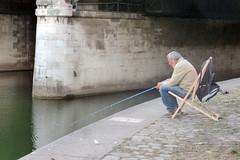 FISHING AT THE CONVERGENCE OF THE DANUBE CANAL AND WIENFLUSS IN VIENNA (artofthemystic) Tags: austria danubecanal vienna urbanart graffiti bridge fishing wienflus