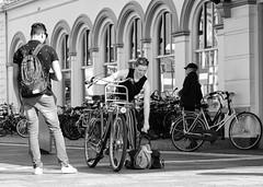 Lift it Up (Hindrik S) Tags: luggage suitcase bag bagage tas bike fyts bicycle fahrrad travel reis reisen reizen reizgje boy indifferent station stasjon ljouwert leeuwarden liwwadden railway meisje vrouw frou frau man mann blackandwhite blackwhite streetphoto strjitfotografy strasenfotografie straatfotografie street strase streetphotography straat strjitte streetlife help helping sonyphotographing sony sonyalpha amount minoltaamount α77 sonyilca77m2 slta77ii 2019 tamronaf16300mmf3563dillvcpzdmacrob016 tamron 16300