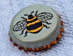 Love the Bee design on this metal beer bottle top. (the.haggishunter) Tags: bottletop lid metal bee design beertop bottle cap macromondays bottlecap